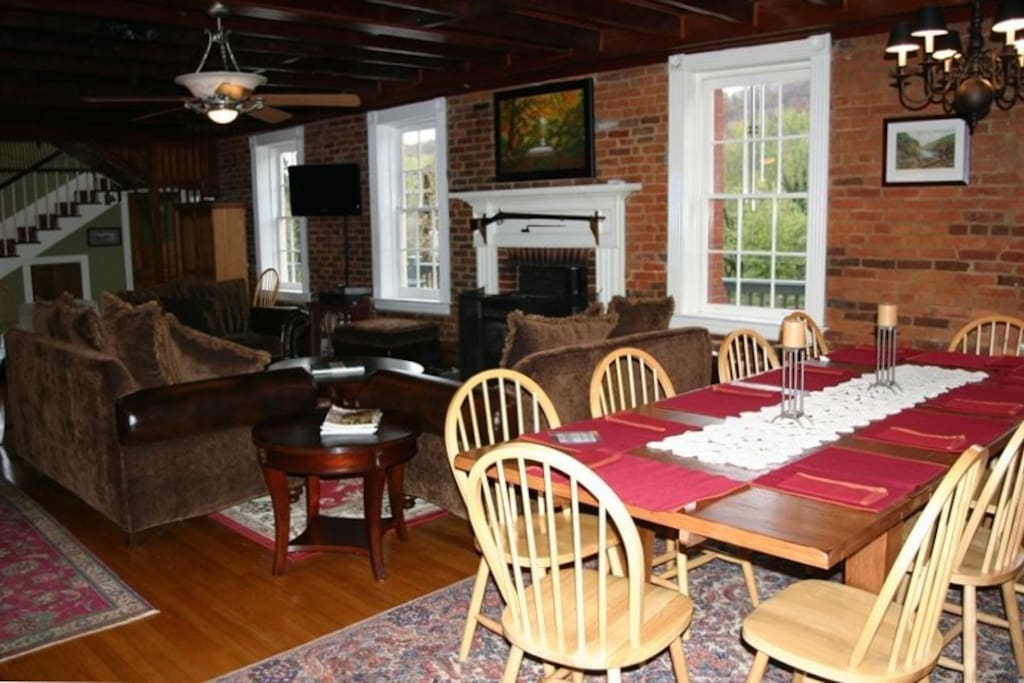 Hardwood floors, exposed brick walls, and exposed beam ceiling. Dining table seating for 10!