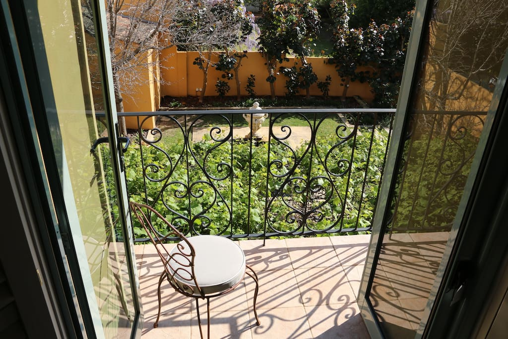Open the French doors to enjoy garden views from your bedroom balcony