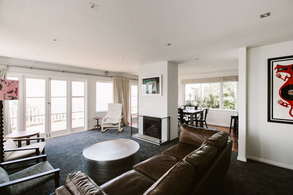 Light and airy open plan living and dining room with incredible views over Wellington harbour