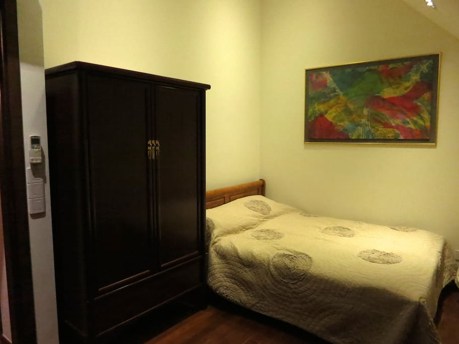 High ceiling, queen size bed with antique wardrobe