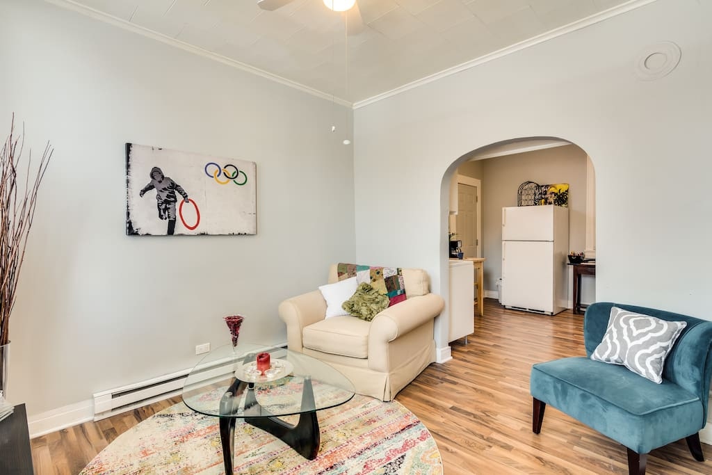 The cozy living room has two chairs - comfortable for reading, watching Netflix, or watching the neighborhood walk by