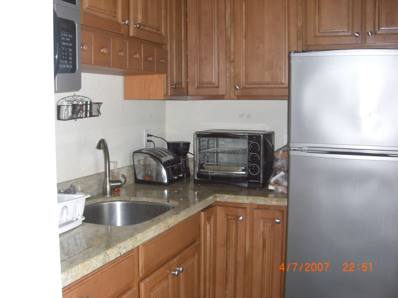 Brand new Granite kitchen and cabinets. Full size refrigerator, large toaster oven, coffee maker, built in microwave, no dishwasher. Private entrance to unit is on right of refrigerator.