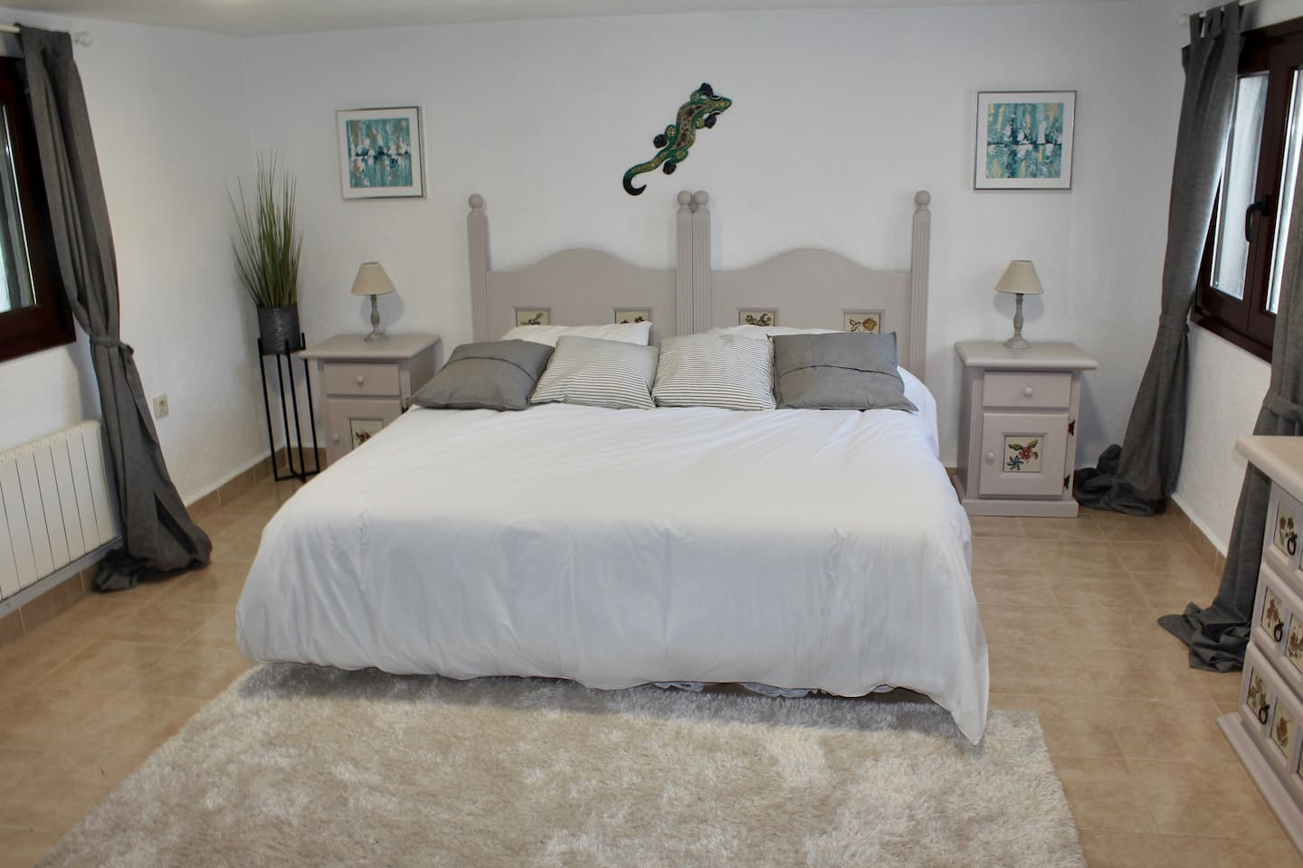 The Super King Bedroom is very spacious with a dressing table, wardrobe and chair.