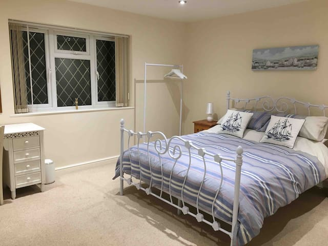 Ground floor - Bedroom 3 with Kingsize bed and enough space to add a travel cot if required