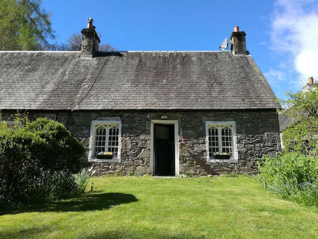 Historic cottage next to loch lomond Luss