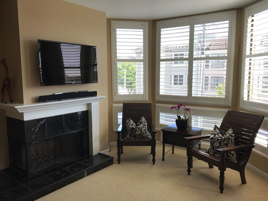 Enjoy a quiet sitting are by the fire or a movie on the swivel flatscreen