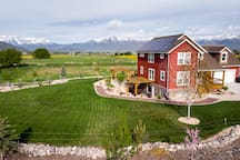 Luxurious basement suite with mountain views, surrounded by fields and wildlife