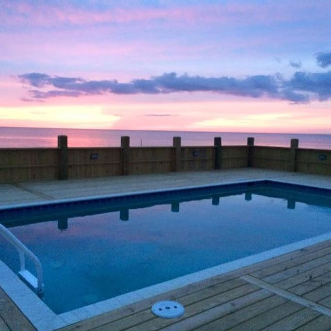 A unique spot in OBX - serene, private, spacious, with heated pool, hot tub, ping pong and access to tennis club nearby. Kick back and relax on the deck with your family and friends and enjoy million dollar views of the water as far as the eye can see! View to the West.