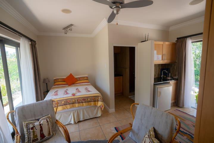 The sleeping area, kitchenette and bathroom