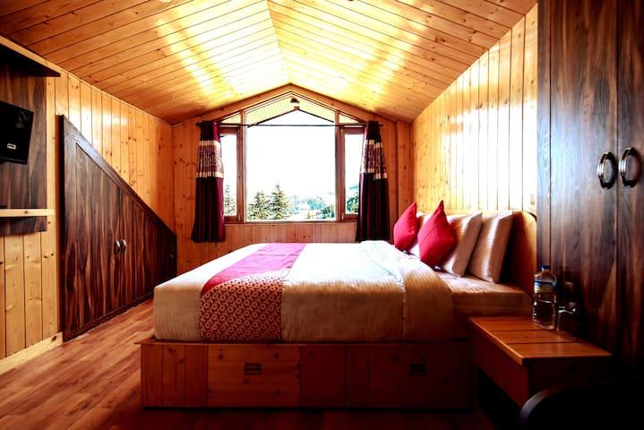 Deluxe Bedroom |Kufri |Attic |Himalayan Vacation.