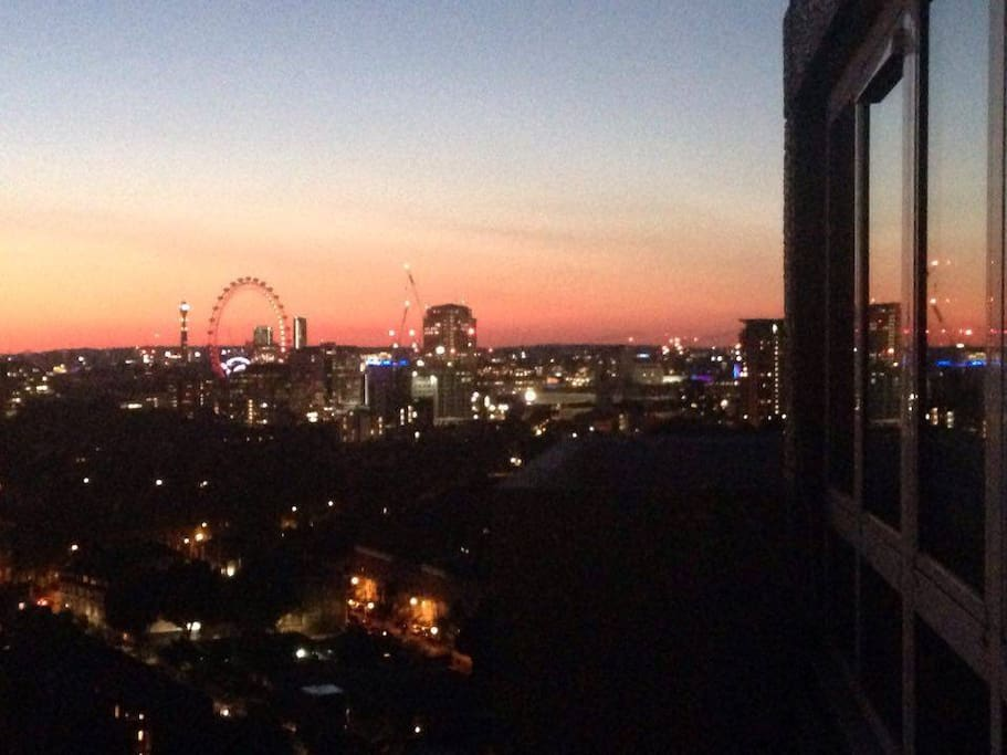 Kitchen balcony view at night with London eye and Big Ben