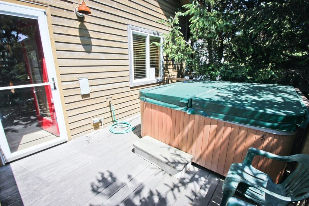 South facing semi-private deck with a hot tub