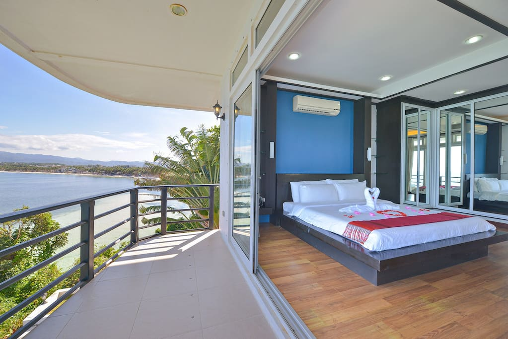 Oceanview master bedroom with terrace patio