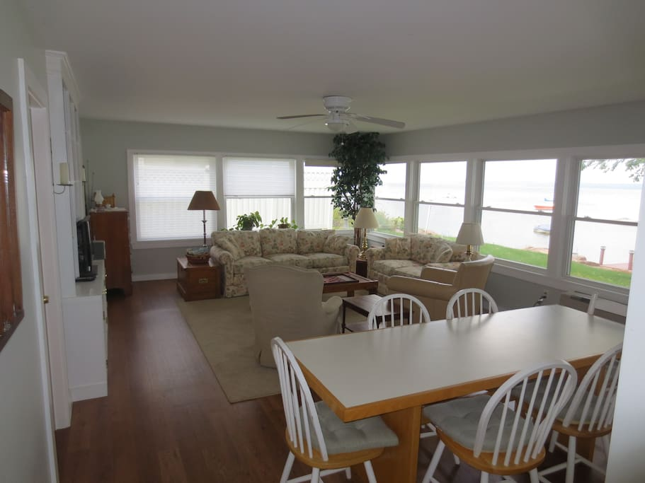 Great room with full lake view, ample seating for dining and relaxation.
