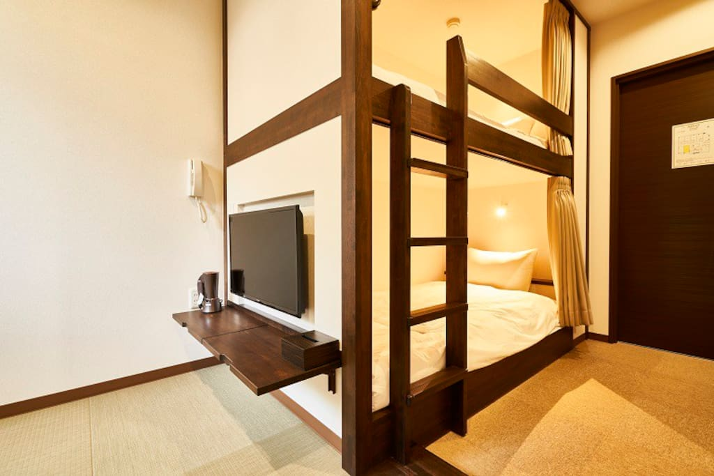 Bedroom with comfortable beds and Japanese-style living.