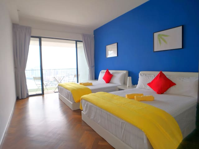 Master bedroom with 2 queen size beds and a private seaview balcony.