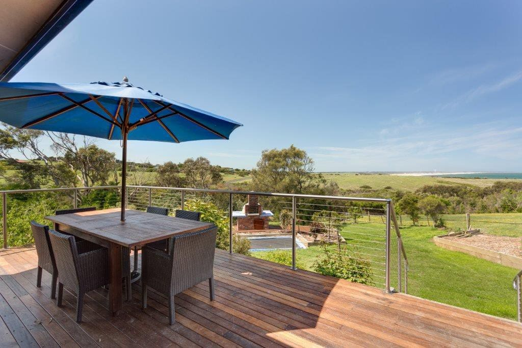 A Patio, Wood Pizza Oven, An InGround Trampoline to Make it A Unique Australia Coast Experience