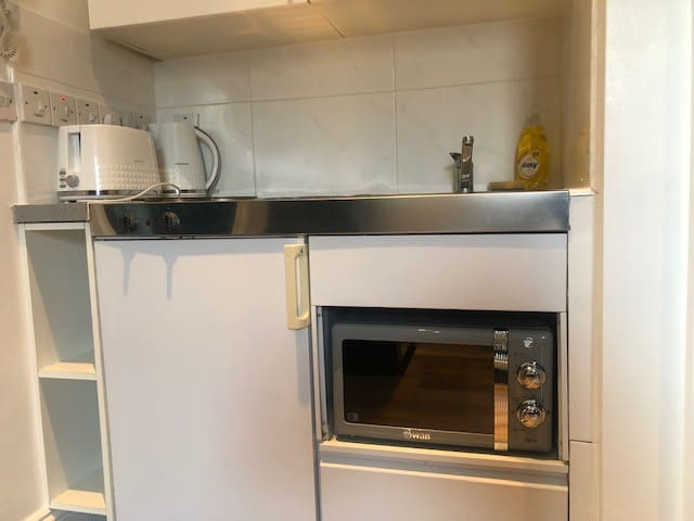 Kitchenette - microwave, fridge, 2 hob stove, sink, kettle and toaster