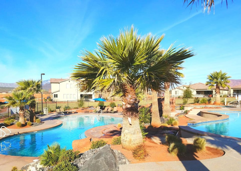 Amazing resort pools with upper and lower pools, waterfall, waterslide, and large hot tub