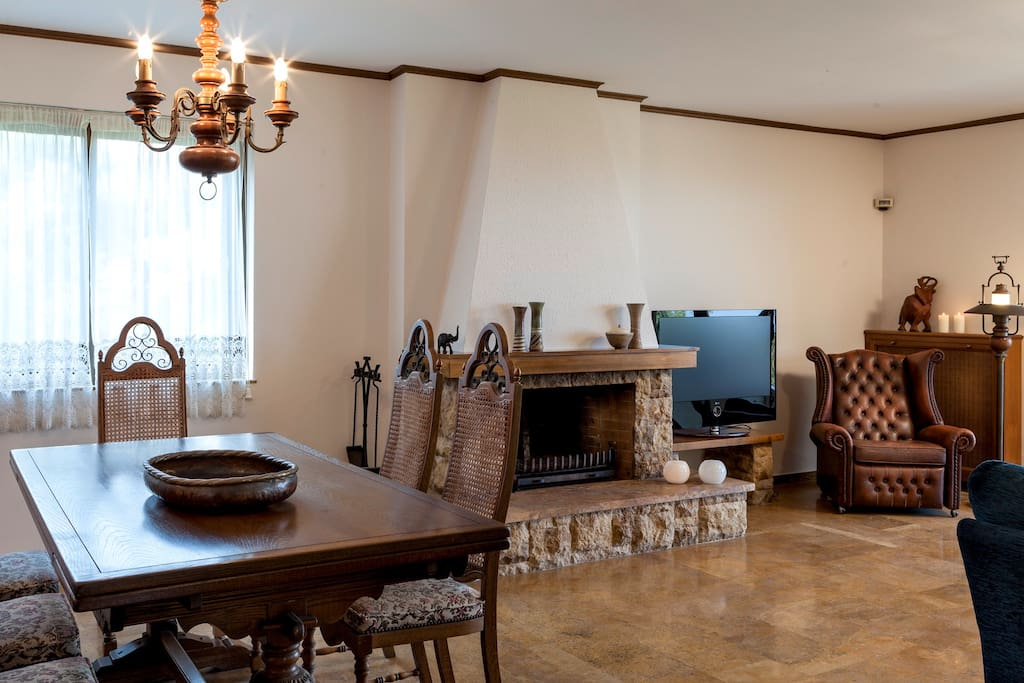 Dining area with wood burning fireplace.