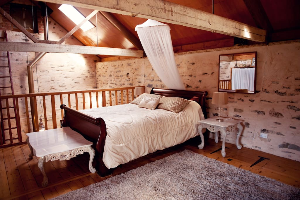 Very spacious loft bedroom has a queen and a single
