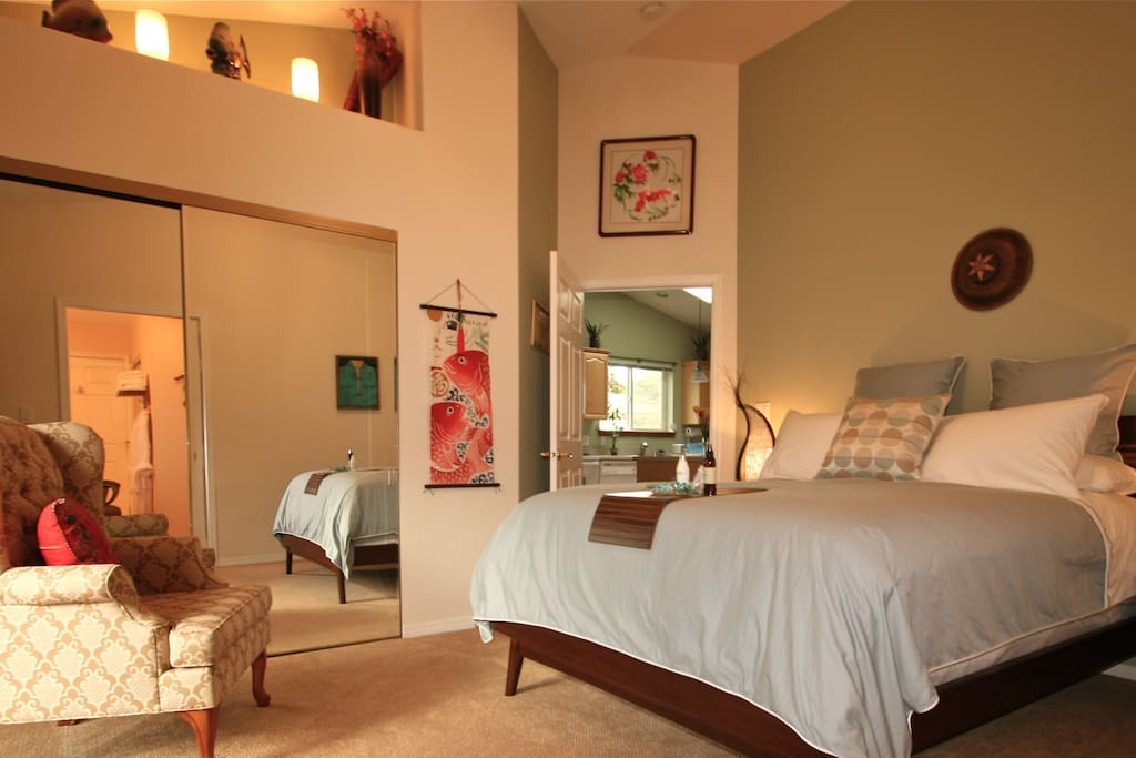 The Deluxe Master Suite has luxurious bedding and a slider to back deck.