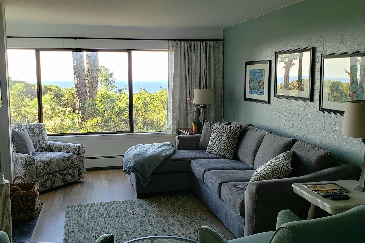 Breathtaking views of the Del Monte Forest and Pacific Ocean from the large picture window in the family room.  There is plenty of seating on the new sofa and chaise lounge. Watch movies on the flat screen ROKU TV or sunsets from the swivel chair.
