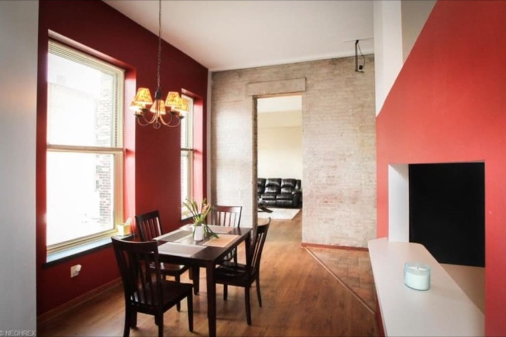 Wood floors, exposed brick, and 15' ceilings throughout!