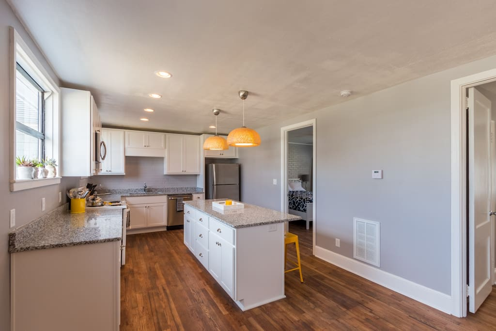 The kitchen directly accesses the bedrooms and opens to the living room
