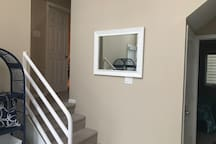 Stairs up to the master bedroom