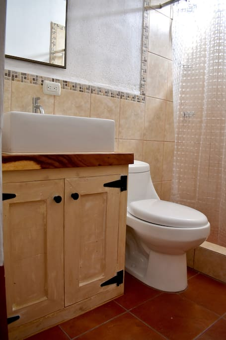 Private bathroom with hot water.