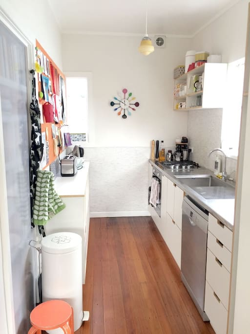 New kitchen with gas hob, electric oven, dishwasher, and fridge (please note: no microwave).