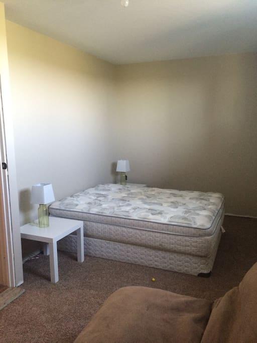 Guest queen bed, with queen futon in corner (sleeps max 4)