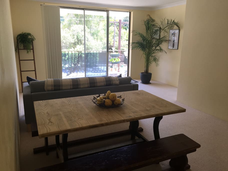 Open plan living/dining room also with private balcony.