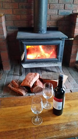 relax by the cosy wood fire  with à glass of wine