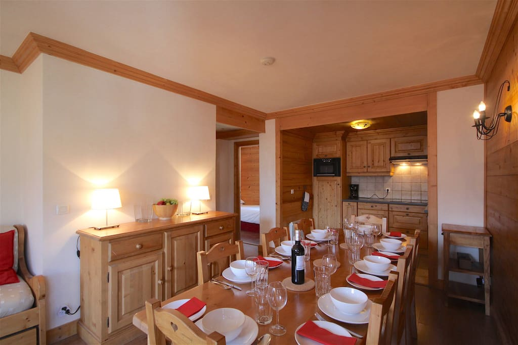 The dining area features a large dining table. There is a sideboard with storage for serving bowls, spare bulbs and extension leads and games, books and DVDs. There is also a bluetooth speaker, 32 inch TV with UK Freesat channels, standard French channels and a blueray/DVD player.