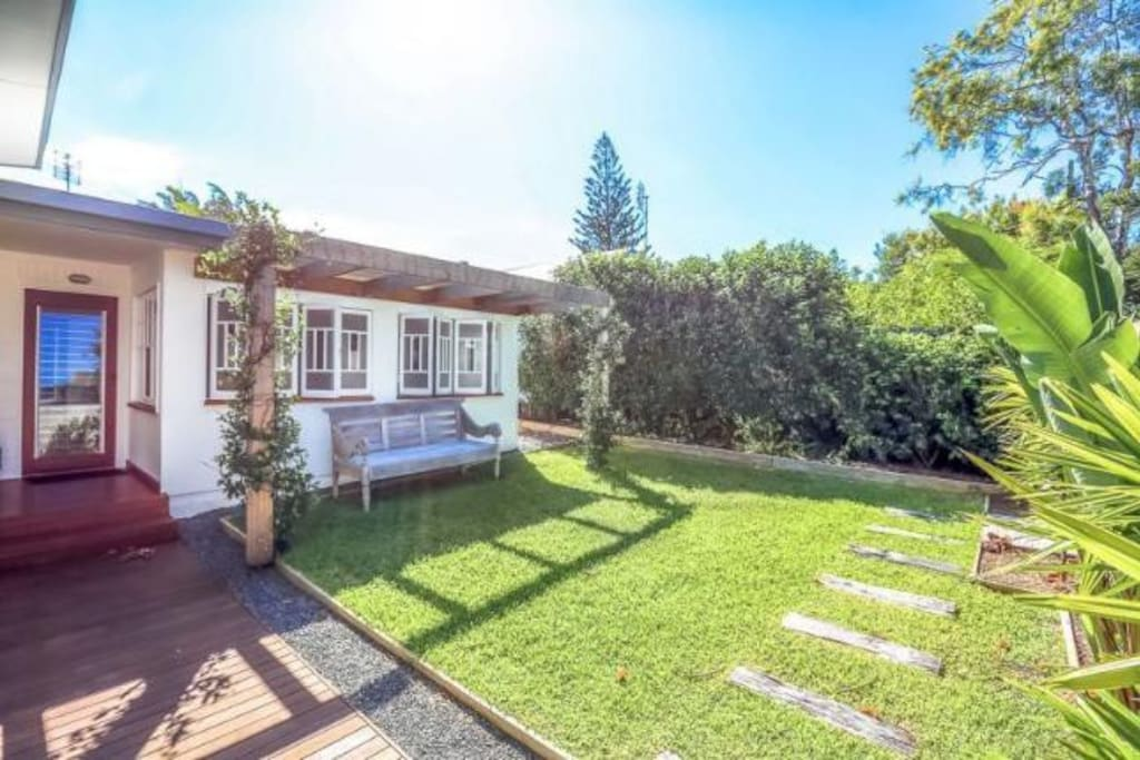 Well maintained lawn, with outdoor shower