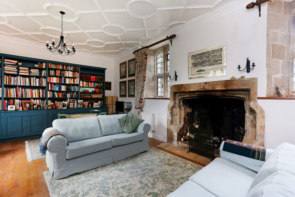 The large, high-ceilinged living room  is great for relaxing in front of the Tudor fireplace, long fire burning,  with a good book, playing the piano ...