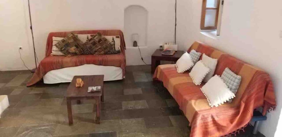 The lounge and sofa beds leading to the Courtyard