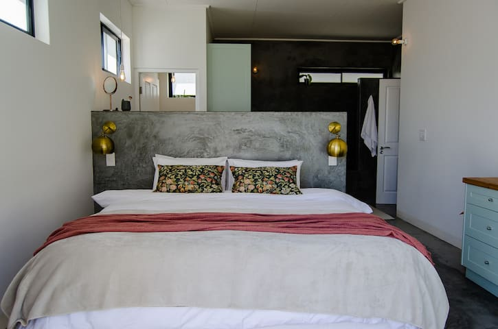 Elegant main bedroom with king size bed.