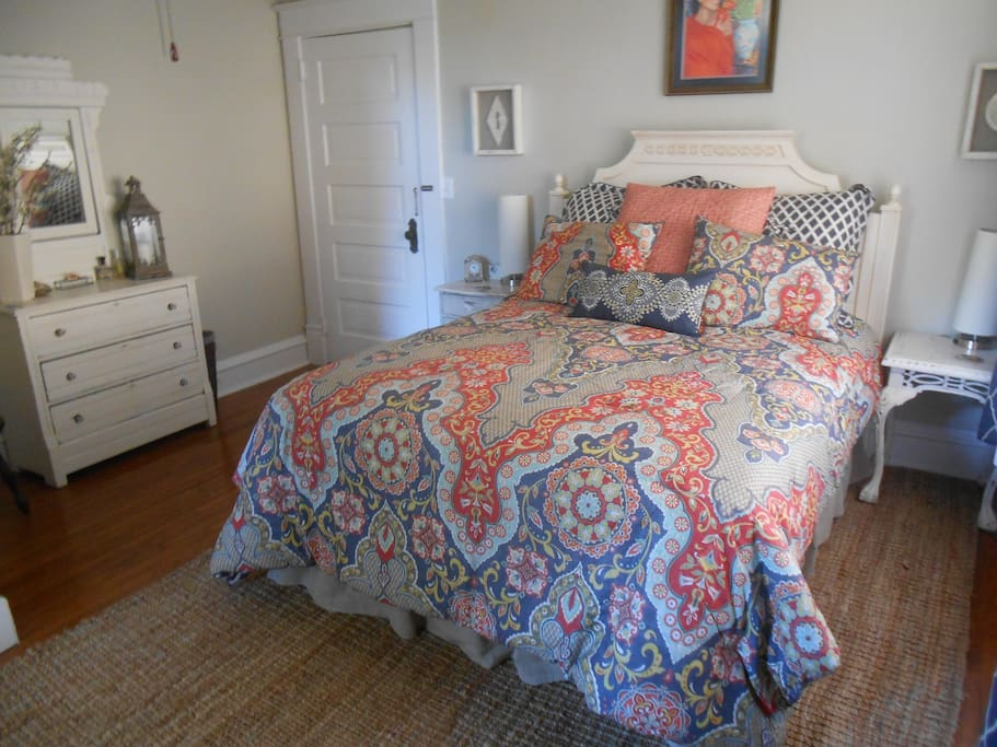 Comfortable queen bed and use of dresser and closet