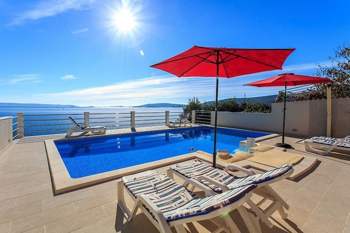 Four bedroom Villa, 200m from city center, beachfront in Seget Vranjica, Outdoor pool