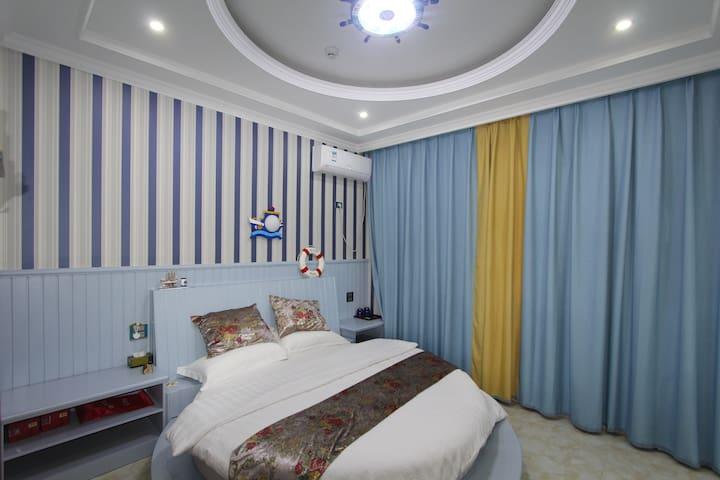 乌镇起风了·驿旅主题客栈 地中海圆床房2米,免费停车。