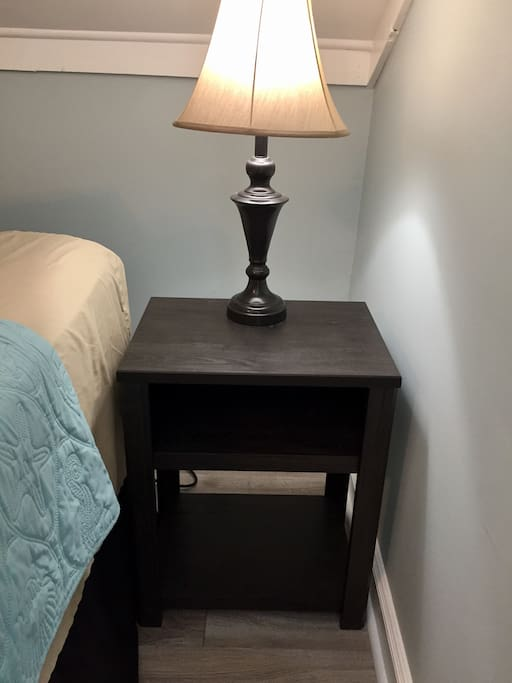 Nice nightstand with shelves.