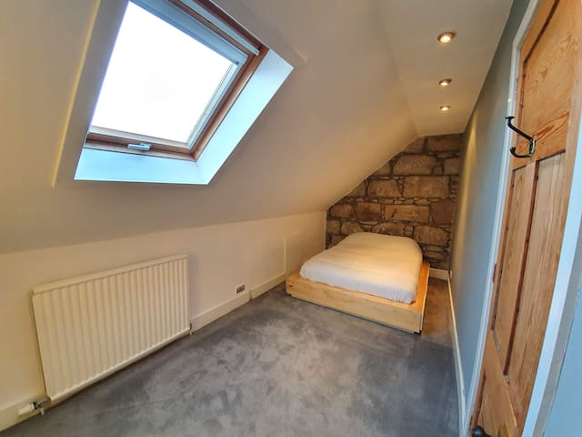 Bright, cosy attic room in charming granite house.