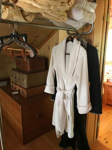 Fluffy robes before the master bedroom door.