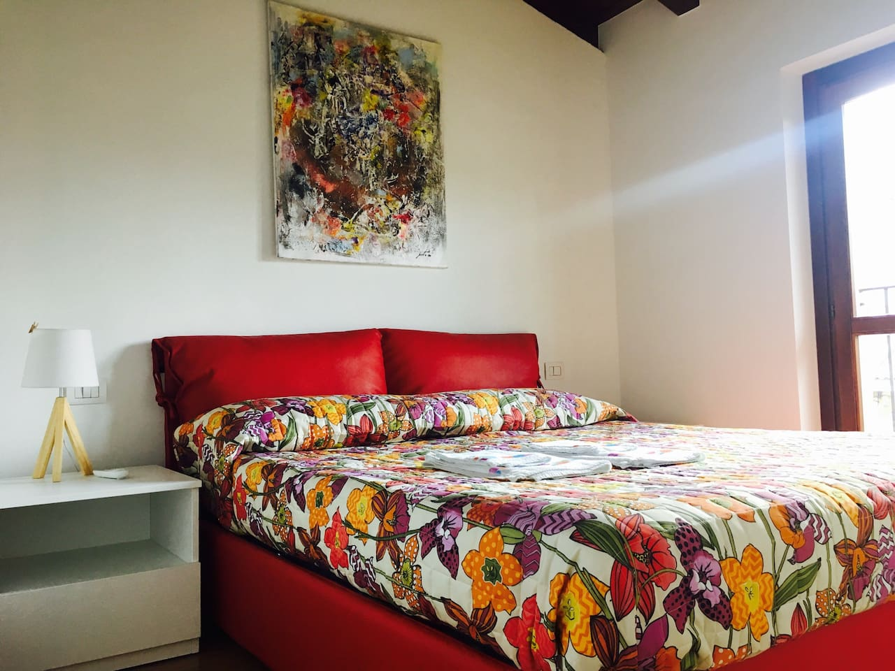 The bedroom equipped with air conditioning as well as the livingroom