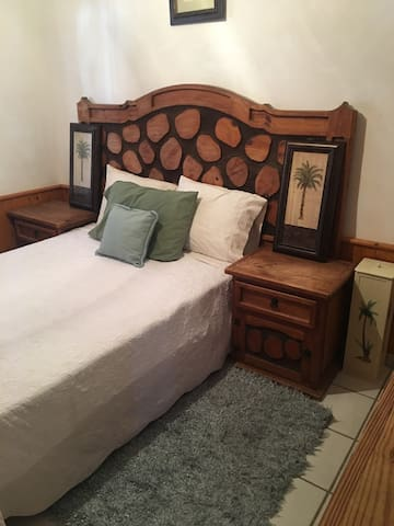 Palma Room with full size bed and additional foam mattress for added comfort.
