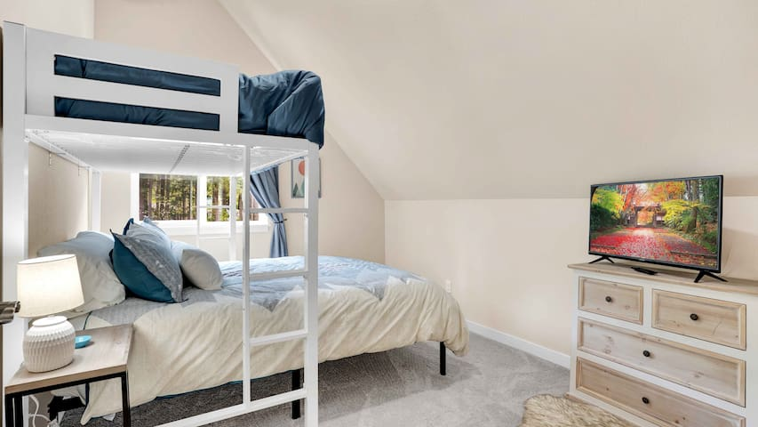 Second upstairs bedroom features a queen size bed with a twin loft