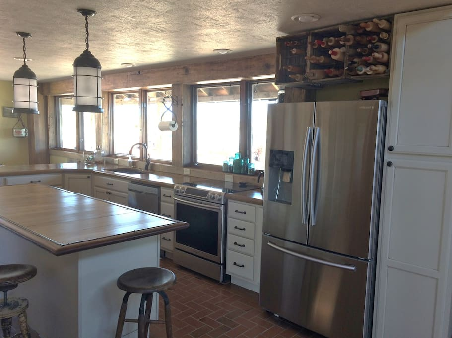 kitchen appliances include double door fridge w/ ice maker and filtered water dispenser, freezer drawer. dishwasher, full electric range, microwave, coffee maker w/ filters. toaster, blender,french press, crock pot,etc. etc.